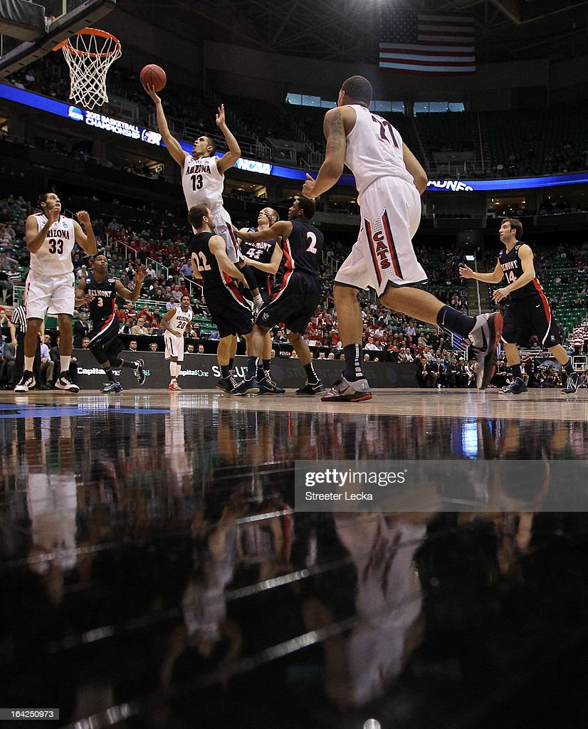 Nick Johnson #13 of the Arizona Wildcats goes up for a shot as he jumps into Reece Chamberlain #22 of the Belmont Bruins in the first half during the second round of the 2013 NCAA Men's Basketball Tournament at EnergySolutions Arena on March 21, 2013 in Salt Lake City, Utah.