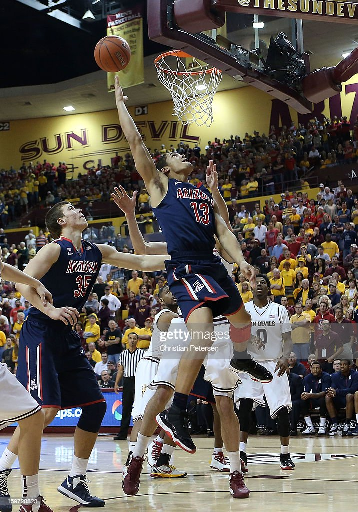 Nick Johnson #13 of the Arizona Wildcats lays up a shot against the Arizona State Sun Devils during the second half of the college basketball game at Wells Fargo Arena on January 19, 2013 in Tempe, Arizona. The Wildcats defeated the Sun Devils 71-54.