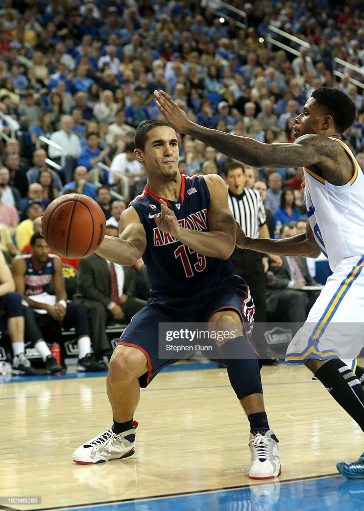 Nick Johnson #13 of the Arizona Wildcats passes the ball around <a gi-track='captionPersonalityLinkClicked' href=/galleries/search?phrase=Larry+Drew+II&family=editorial&specificpeople=5088949 ng-click='$event.stopPropagation()'>Larry Drew II</a> #10 of the UCLA Bruins at Pauley Pavilion on March 2, 2013 in Los Angeles, California. UCLA won 74-69.