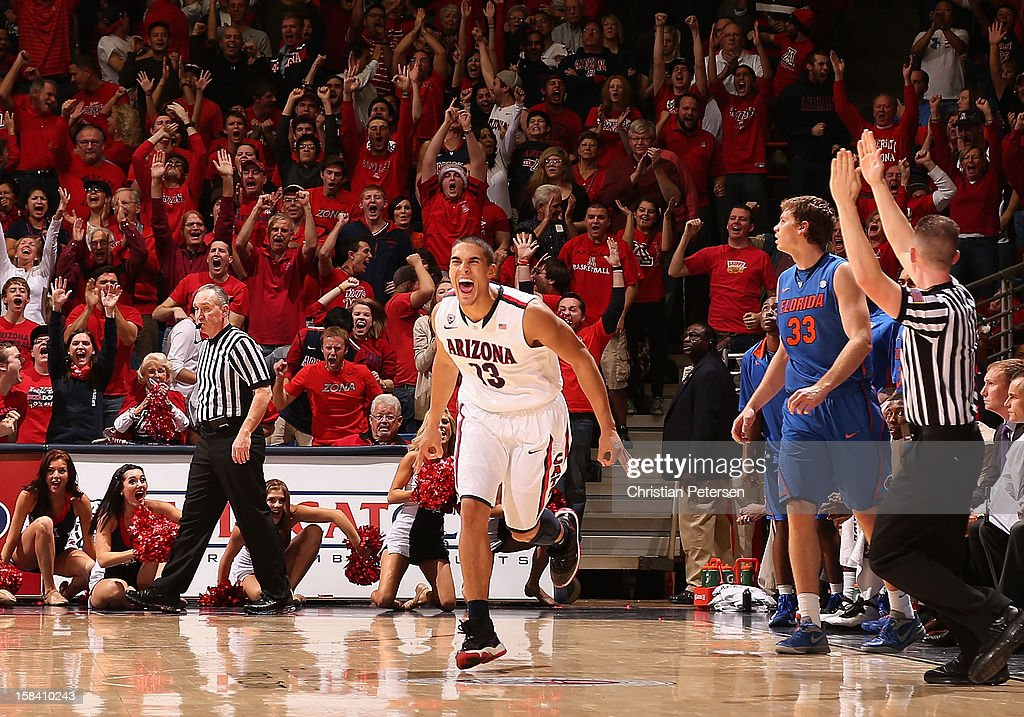Nick Johnson #13 of the Arizona Wildcats reacts after hitting a three point shot against the Florida Gators late in the first half of the college basketball game at McKale Center on December 15, 2012 in Tucson, Arizona.