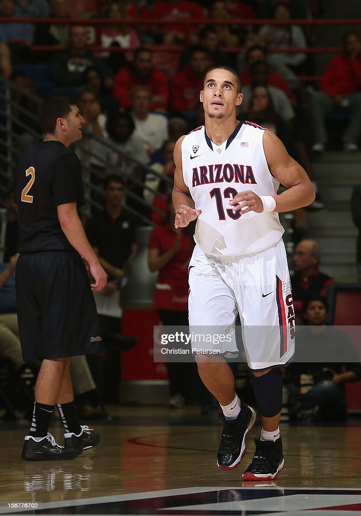 Nick Johnson #13 of the Arizona Wildcats reacts after scoring against the Long Beach State 49ers during the college basketball game at McKale Center on November 19, 2012 in Tucson, Arizona. The Wildcats defeated the 49ers 94-72.