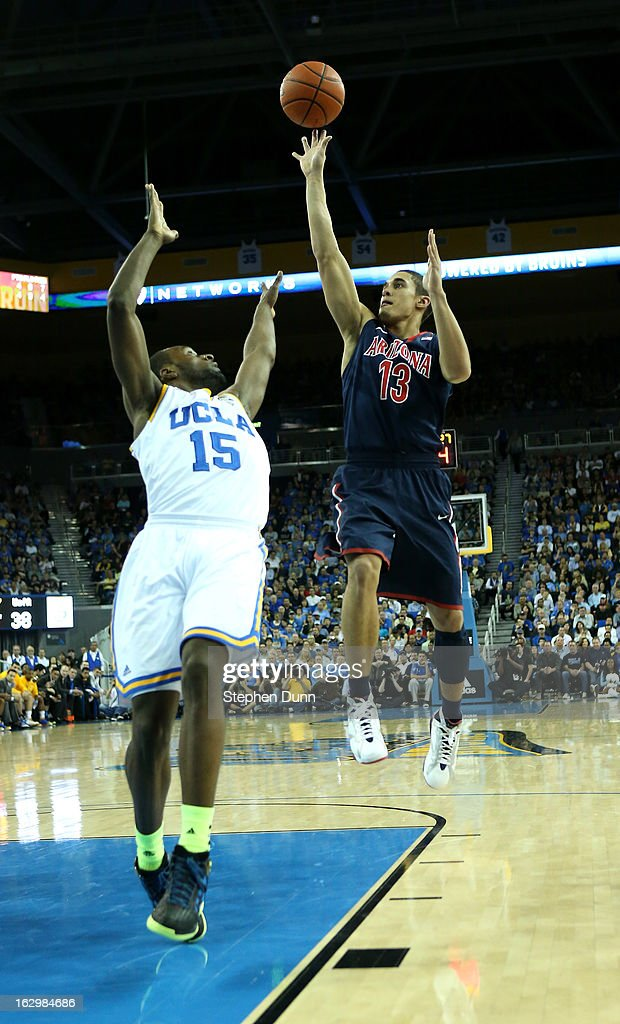 Nick Johnson #13 of the Arizona Wildcats shoots over <a gi-track='captionPersonalityLinkClicked' href=/galleries/search?phrase=Shabazz+Muhammad&family=editorial&specificpeople=7447677 ng-click='$event.stopPropagation()'>Shabazz Muhammad</a> #15 of the UCLA Bruins at Pauley Pavilion on March 2, 2013 in Los Angeles, California. UCLA won 74-69.