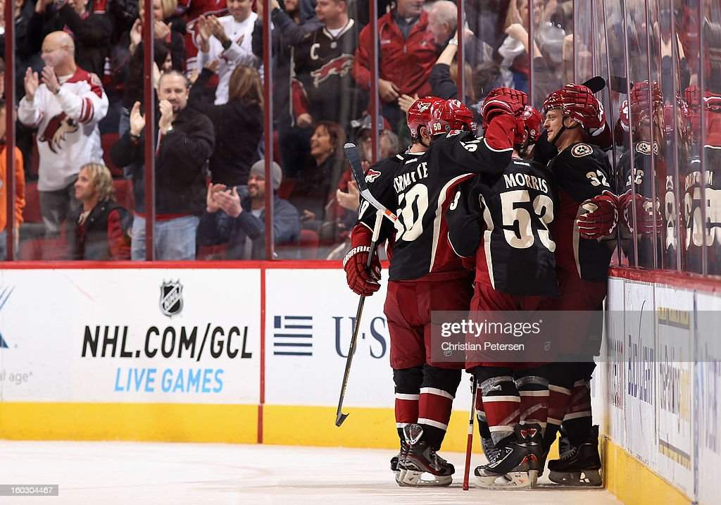 Nick Johnson #32 (R) of the Phoenix Coyotes celebrates with teammates after Johnson scored a third period goal against the Nashville Predators during the NHL game at Jobing.com Arena on January 28, 2013 in Glendale, Arizona. The Coyotes defeated the Predators 4-0.