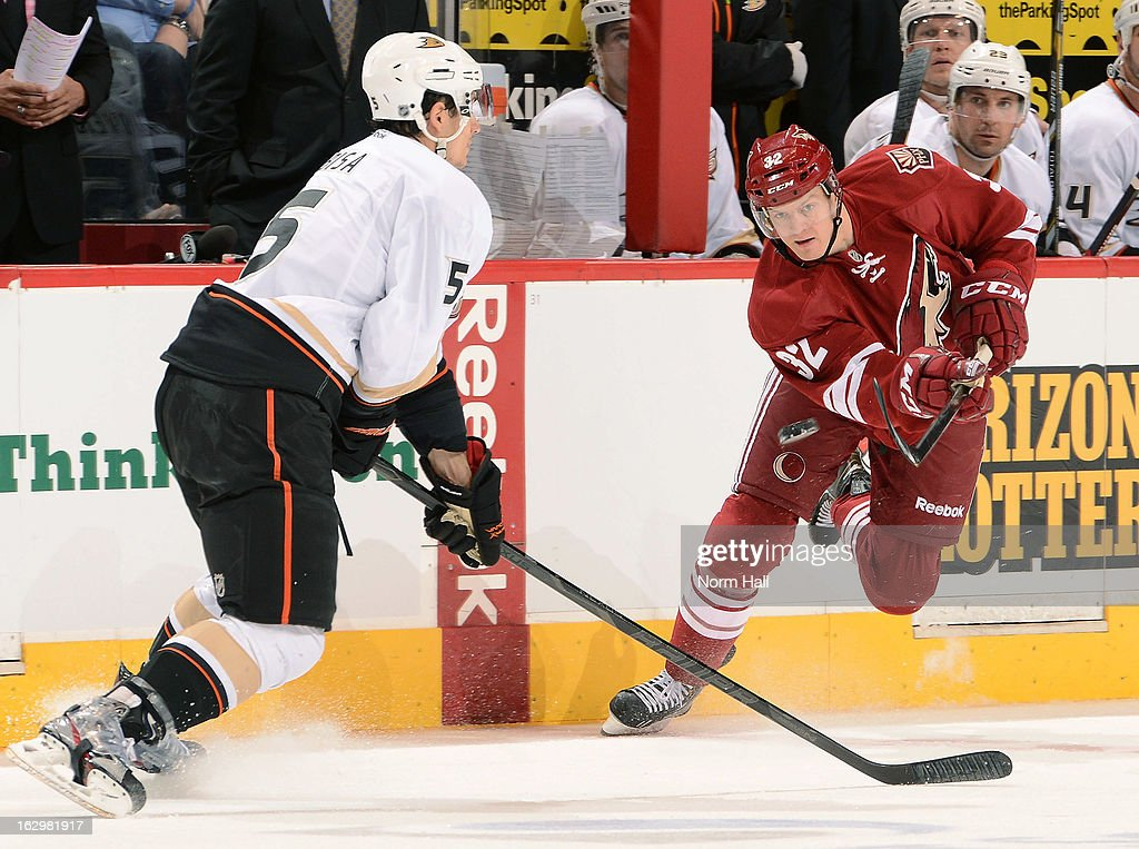 Nick Johnson #32 of the Phoenix Coyotes dumps the puck up ice past <a gi-track='captionPersonalityLinkClicked' href=/galleries/search?phrase=Luca+Sbisa&family=editorial&specificpeople=4893043 ng-click='$event.stopPropagation()'>Luca Sbisa</a> #5 of the Anaheim Ducks at Jobing.com Arena on March 2, 2013 in Glendale, Arizona.