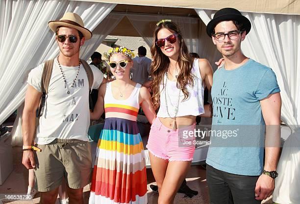 Nick Jonas actress Annasophia Robb model Alessandra Ambrosio and Joe Jonas attend LACOSTE LVE 4th Annual Desert Pool Party on April 13 2013 in...