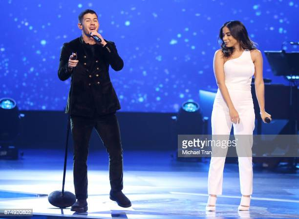 Nick Jonas and Anitta perform onstage during The Latin Recording Academy's 2017 Person of The Year Gala held at the Mandalay Bay Convention Center on...