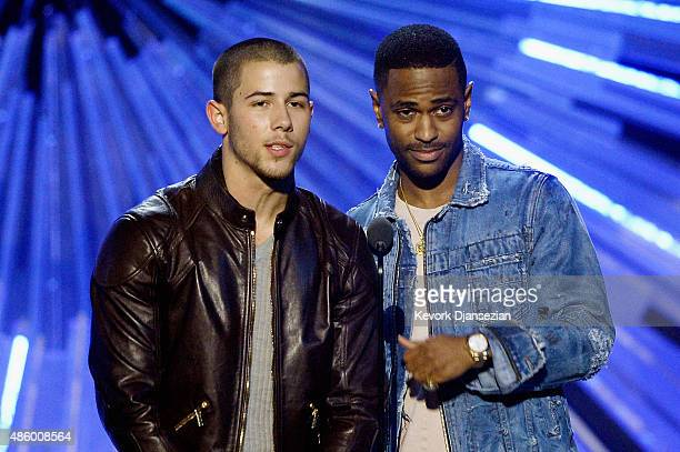 Nick Jonas and Big Sean speak onstage during the 2015 MTV Video Music Awards at Microsoft Theater on August 30 2015 in Los Angeles California
