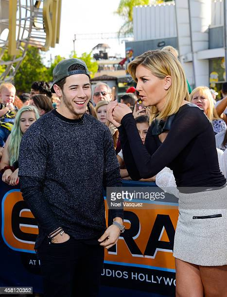 Nick Jonas and Charissa Thompson visit 'Extra' at Universal Studios Hollywood on October 30 2014 in Universal City California