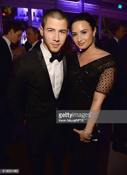 Nick Jonas and Demi Lovato attend the 2016 Vanity Fair Oscar Party Hosted By Graydon Carter at the Wallis Annenberg Center for the Performing Arts on...