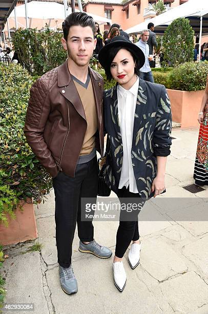 Nick Jonas and Demi Lovato attend the Roc Nation and Three Six Zero PreGRAMMY Brunch at Private Residence on February 7 2015 in Beverly Hills...