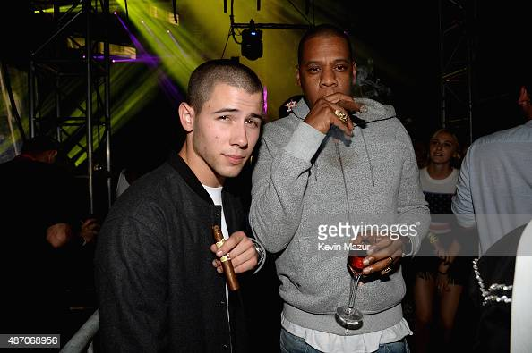 Nick Jonas and Jay Z appear backstage during the 2015 Budweiser Made in America Festival at Benjamin Franklin Parkway on September 5 2015 in...