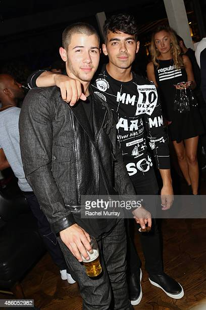 Nick Jonas and Joe Jonas attend Republic Records 2015 VMA after party at Ysabel on August 30 2015 in West Hollywood California