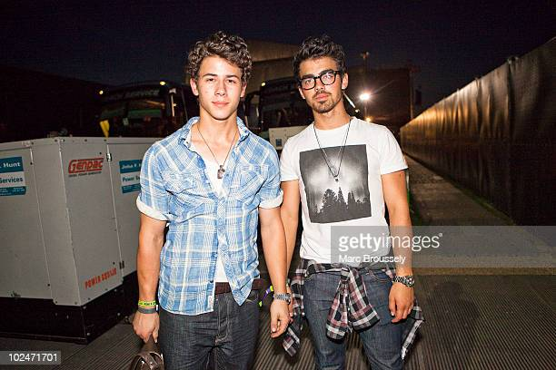 Nick Jonas and Joe Jonas of the Jonas Brothers behind the main stage after attending Paul McCartney's headlining performance on day 3 of Hard Rock...