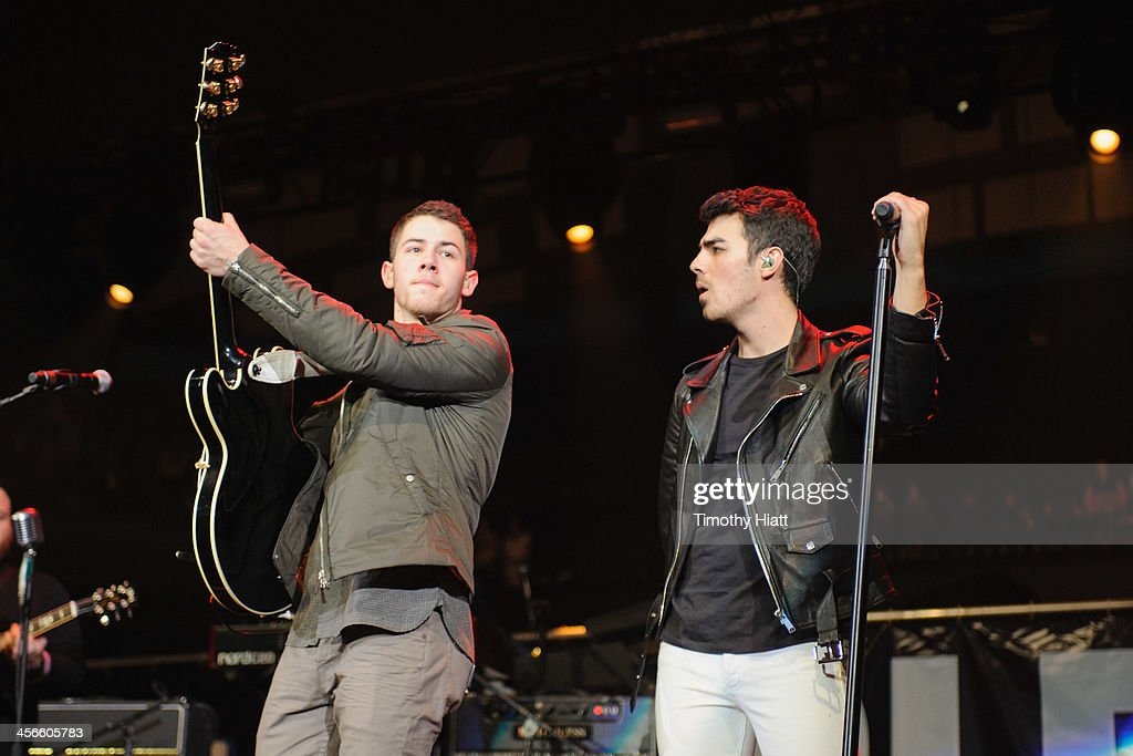 Nick Jonas and Joe Jonas perform during the B96 Pepsi Jingle Bash at Allstate Arena on December 14, 2013 in Chicago, Illinois.