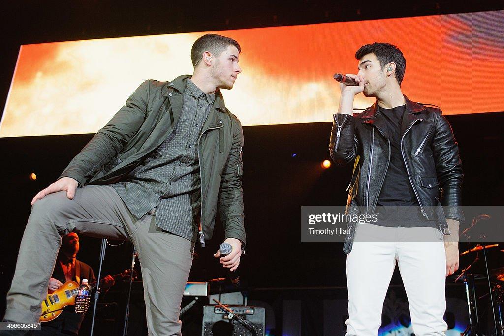 Nick Jonas and Joe Jonas perform during the B96 Pepsi Jingle Bash at Allstate Arena on December 14, 2013 in Chicago, Illinois.