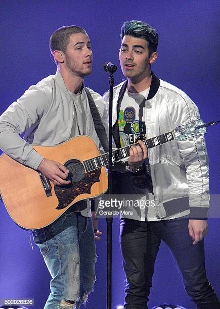 Nick Jonas and Joe Jonas perform onstage during 933 FLZ's Jingle Ball 2015 Presented by Capital One at Amalie Arena on December 19 2015 in Tampa Bay...
