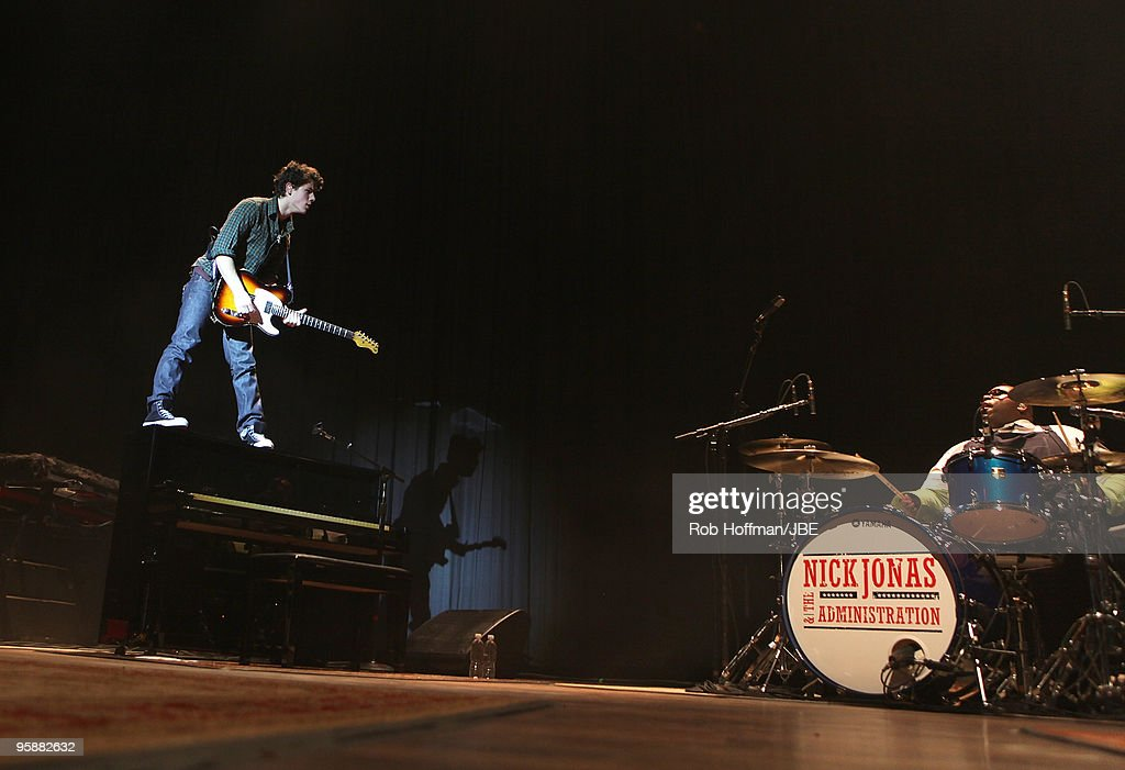 Nick Jonas and Michael Bland performs during the Nick Jonas The Administration tour on January 19 2010 in St Louis Missouri