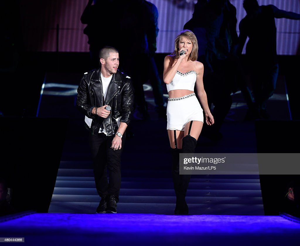 Nick Jonas and Taylor Swift perform onstage during The 1989 World Tour Live at MetLife Stadium on July 11 2015 in East Rutherford New Jersey