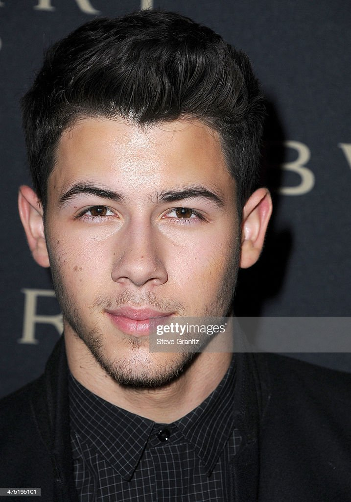 Nick Jonas arrives at the BVLGARI 'Decades Of Glamour' Oscar Party Hosted By Naomi Watts at Soho House on February 25, 2014 in West Hollywood, California.