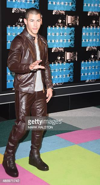 Nick Jonas arrives on the red carpet at the MTV Video Music Awards August 30 2015 at the Microsoft Theater in Los Angeles California AFP PHOTO/Mark...