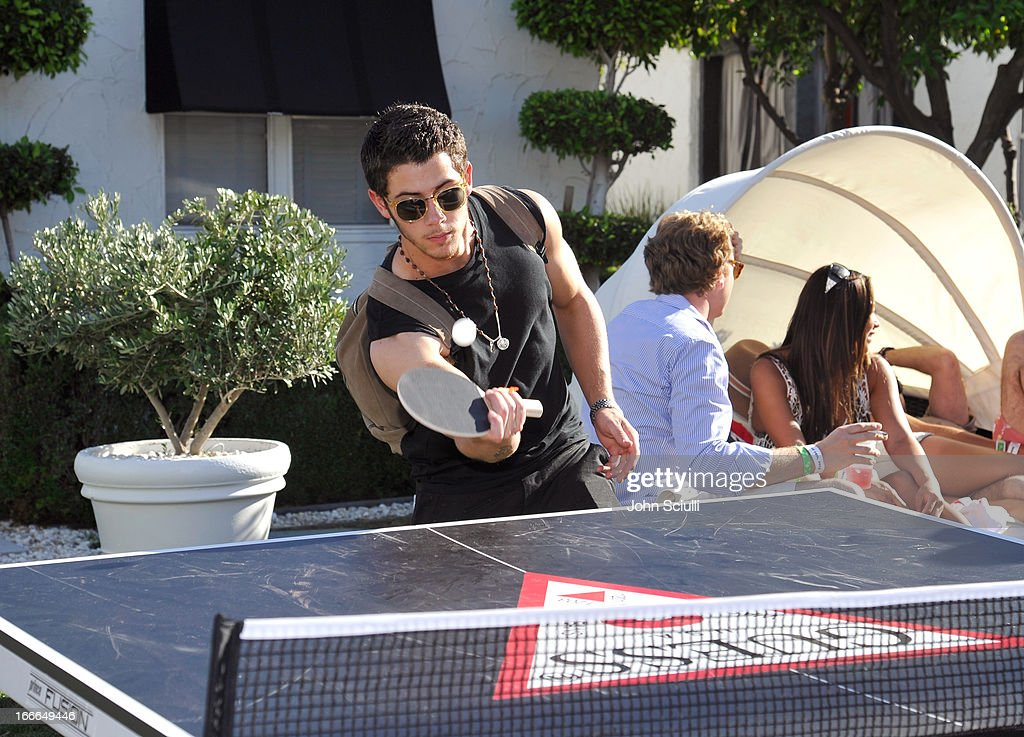 <a gi-track='captionPersonalityLinkClicked' href=/galleries/search?phrase=Nick+Jonas&family=editorial&specificpeople=842713 ng-click='$event.stopPropagation()'>Nick Jonas</a> attends the GUESS Hotel pool party at the Viceroy Palm Springs on April 14, 2013 in Palm Springs, California.