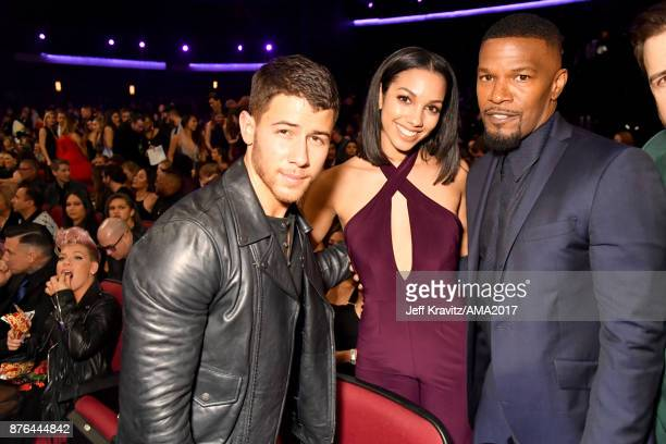 Nick Jonas Corinne Foxx and Jamie Foxx at the 2017 American Music Awards at Microsoft Theater on November 19 2017 in Los Angeles California