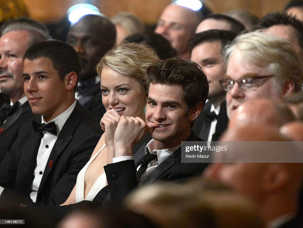 Nick Jonas Emma Stone Andrew Garfield and Philip Seymour Hoffman attend the 66th Annual Tony Awards at The Beacon Theatre on June 10 2012 in New York...