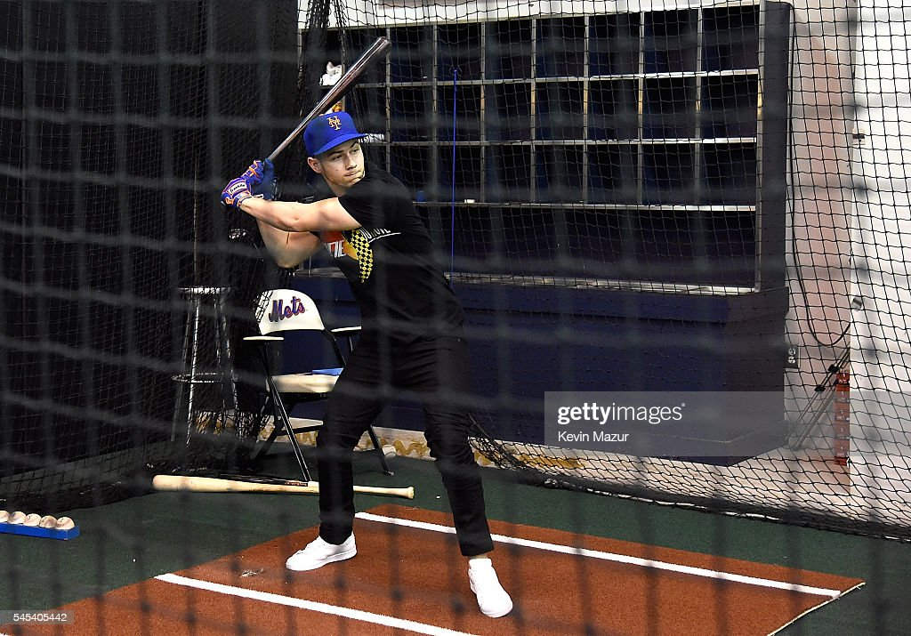 Nick Jonas hits a ball in the batting cages before a New York Mets game at Citi Field on July 7 2016 in New York City