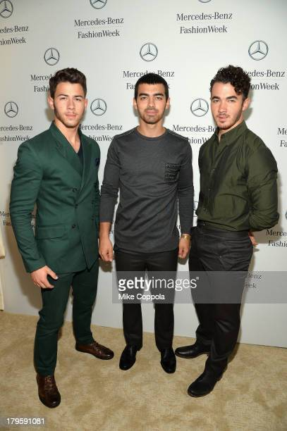 Nick Jonas Joe Jonas and Kevin Jonas of the Jonas Brothers attend the MercedesBenz Star Lounge during MercedesBenz Fashion Week Spring 2014 at...