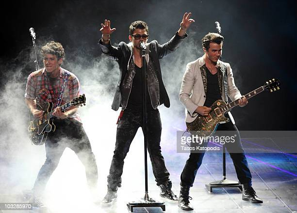 Nick Jonas Joe Jonas and Kevin Jonas of The Jonas Brothers performs during the 'Jonas Brothers Live In Concert' tour opener at the First Midwest Bank...