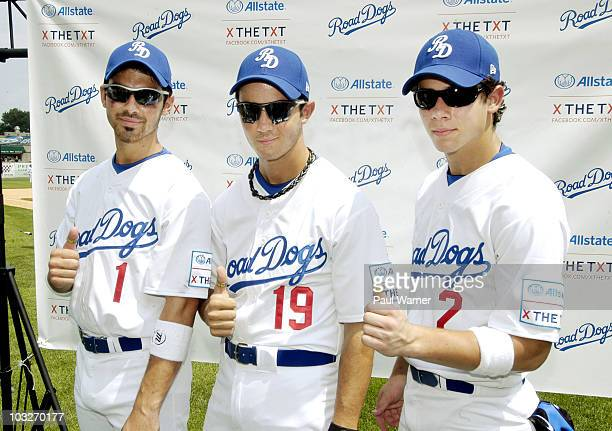 Nick Jonas Kevin Jonas and Joe Jonas of the Jonas Brothers attend the Road Dogs softball game at Silver Cross Field on August 6 2010 in Joliet...