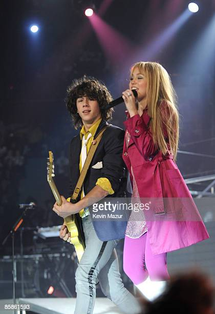 UNIONDALE NY APRIL 07 *EXCLUSIVE* Nick Jonas of the Jonas Brothers and Miley Cyrus perform during her 'Best of Both Worlds' tour at Nassau Coliseum...
