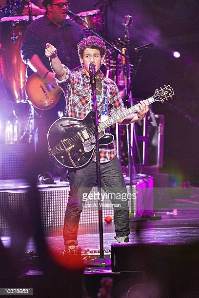 Nick Jonas performs during the 'Jonas Brothers Live In Concert' tour opener at the First Midwest Bank Amphitheatre on August 7 2010 in Tinley Park...