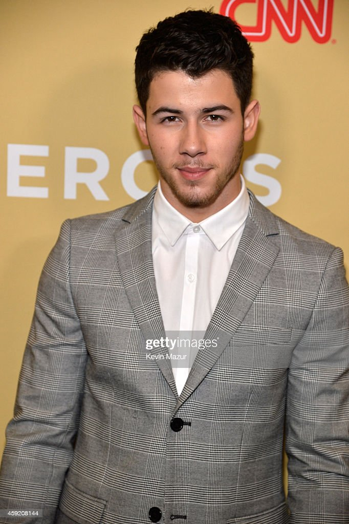 Nick Jonas poses backstage during the 2014 CNN Heroes An All Star Tribute at American Museum of Natural History on November 18 2014 in New York City...