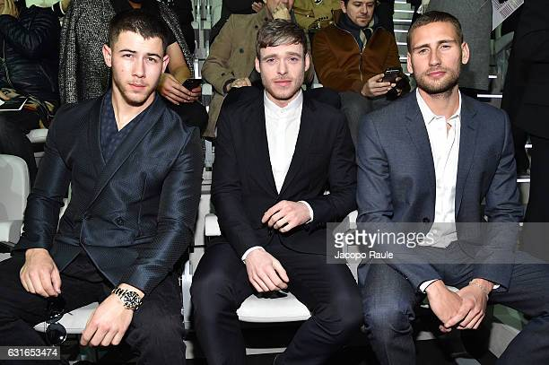 Nick Jonas Richard Madden and Edward Holcroft attend the Emporio Armani show during Milan Men's Fashion Week Fall/Winter 2017/18 on January 14 2017...