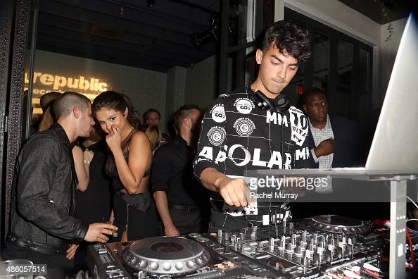 Nick Jonas Selena Gomez and Joe Jonas attend Republic Records 2015 VMA after party at Ysabel on August 30 2015 in West Hollywood California