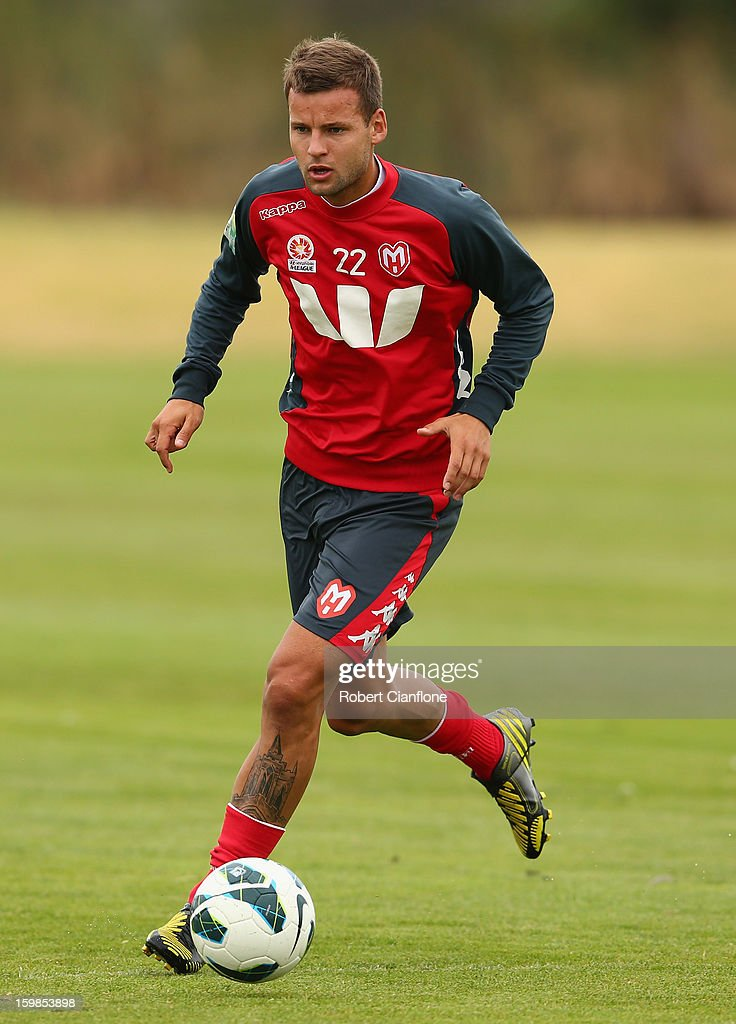 Nick Kalmar of the Heart runs with the ball during a Melbourne Heart A-League training session at La Trobe University Sports Fields on January 22, 2013 in Melbourne, Australia.
