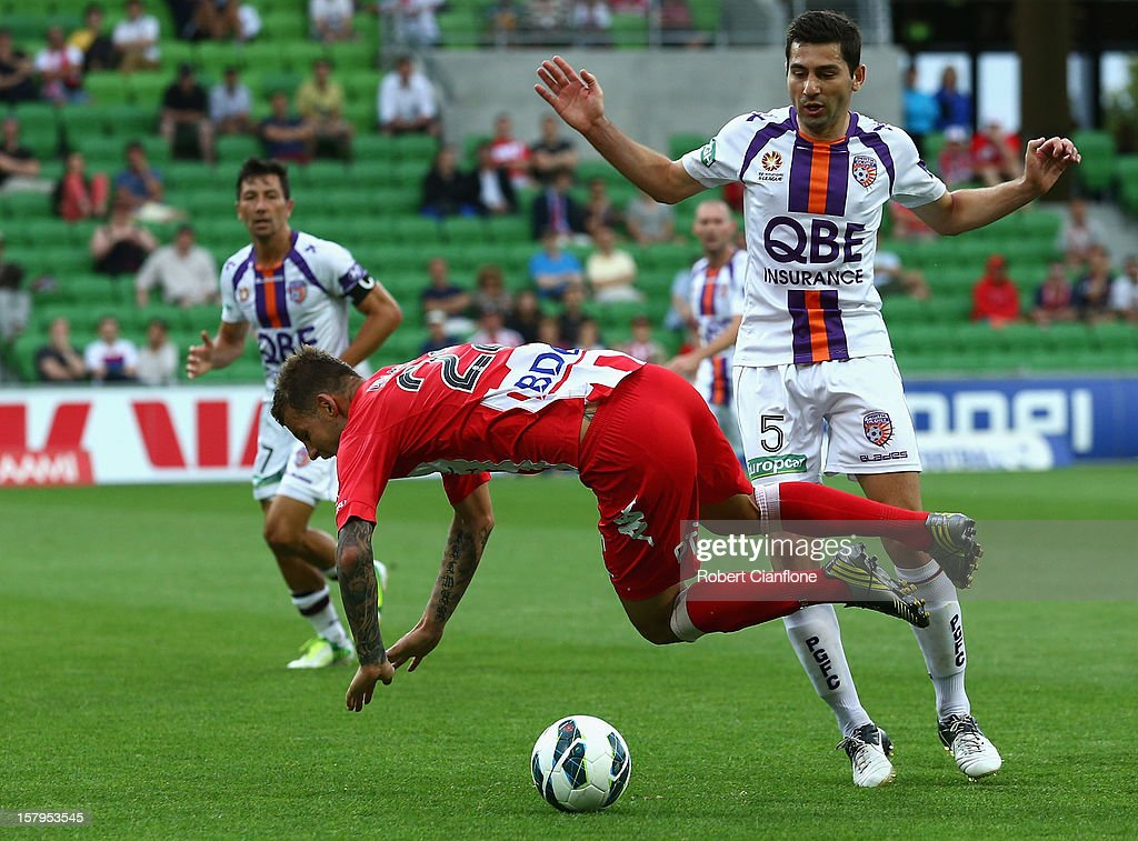 Nick Kalmar of the Heart trips over Steve Pantelidis of the Glory during the round 10 A-League match between the Melbourne Heart and the Perth Glory at AAMI Park on December 8, 2012 in Melbourne, Australia.