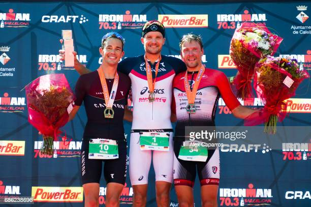 Nick Kastelein of Australia in 2nd place Jan Frodeno of Germany in 1st place and Ivan Tutukin of Russia in 3rd place celebrate their results at the...