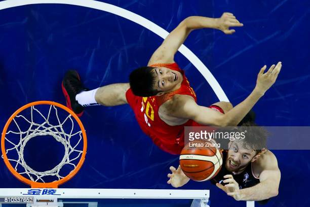 Nick Kay of Australia drives to the basket against Hu Jinqiu of China during the 2017 SinoAustralia Men's International Basketball Challenge at Jilin...