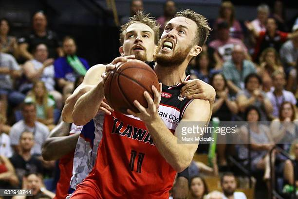 Nick Kay of the Hawks is challenged by Anthony Drmic of the 36ers during the round 17 NBL match between the Illawarra Hawks and the Adelaide 36ers at...