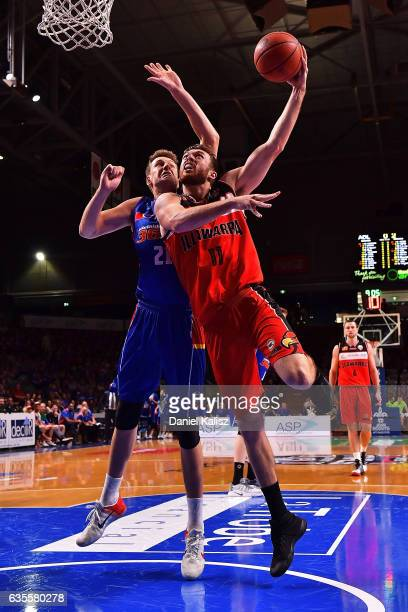 Nick Kay of the Illawarra Hawks drives to the basket as Daniel Johnson of the Adelaide 36ers defends during the game one NBL Semi Final between...