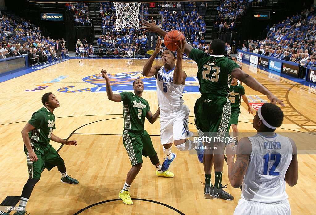 Nick King #5 of the Memphis Tigers drives to the basket for a layup against Chris Perry #23 of the USF Bulls on January 26, 2014 at FedExForum in Memphis, Tennessee. Memphis beat South Florida 80-58.
