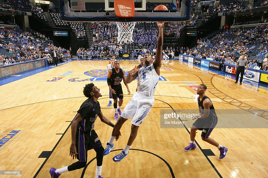 Nick King of the Memphis Tigers drives to the basket for a layup against the Prairie View AM Panthers on November 24 2014 at FedExForum in Memphis...