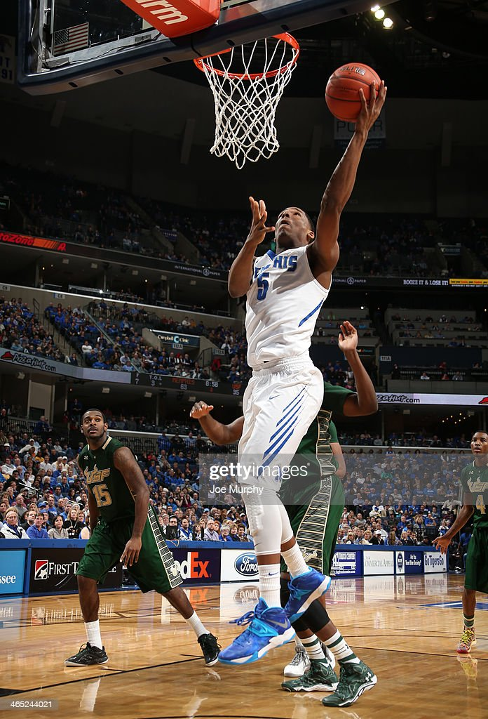 Nick King #5 of the Memphis Tigers shoots a layup against the USF Bulls on January 26, 2014 at FedExForum in Memphis, Tennessee. Memphis beat South Florida 80-58.