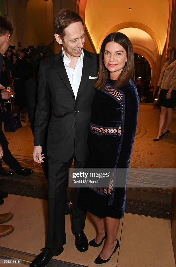 Nick Knight (L) and Natalie Massenet attend a private view of 'Vogue 100: A Century of Style' hosted by Alexandra Shulman and Leon Max at the National Portrait Gallery on February 9, 2016 in London, England.