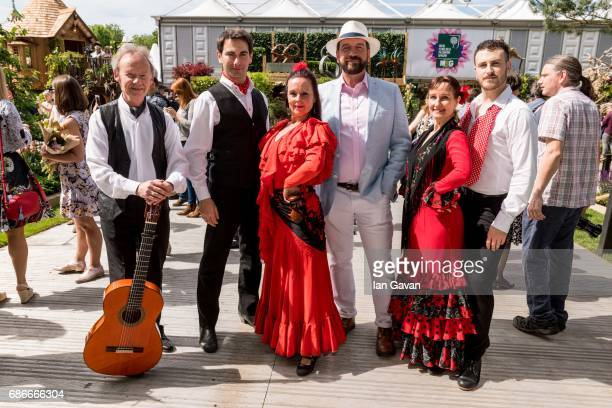 Nick Knowles poses with traditional Spanish flamenco dancers accompanied by Spanish guitar perform at the RHS Chelsea Flower Show on May 22 2017 in...
