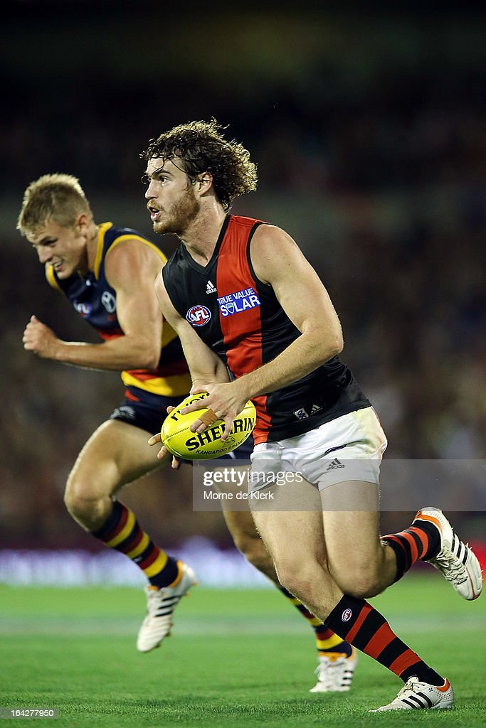 Nick Kommer of the Bombers runs with the ball during the round one AFL match between the Adelaide Crows and the Essendon Bombers at AAMI Stadium on March 22, 2013 in Adelaide, Australia.