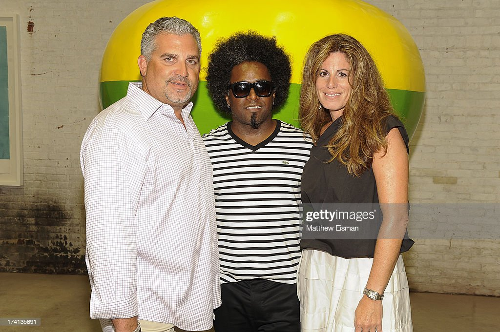 Nick Korniloff, Alexandre Arrechea and Pamela Cohen attend Hamptons Magazine celebrates an Evening of Banksy at Keszler Gallery on July 20, 2013 in Southampton, New York.