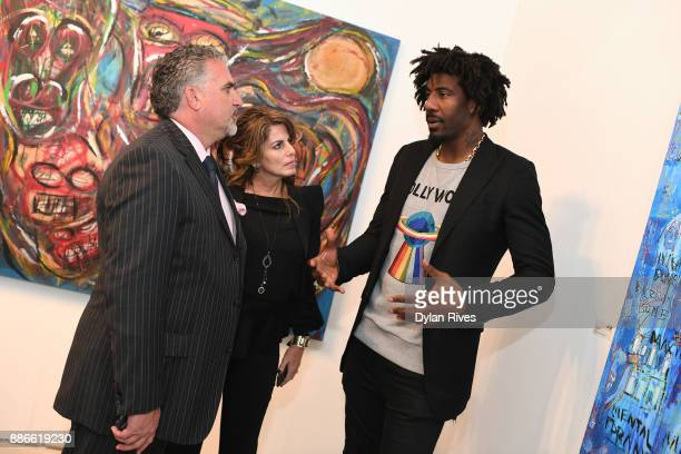 Nick Korniloff Pamela Cohen and Amar'e Stoudemire attend the Art Miami CONTEXT 2017 at Art Miami Pavilion on December 5 2017 in Miami Florida